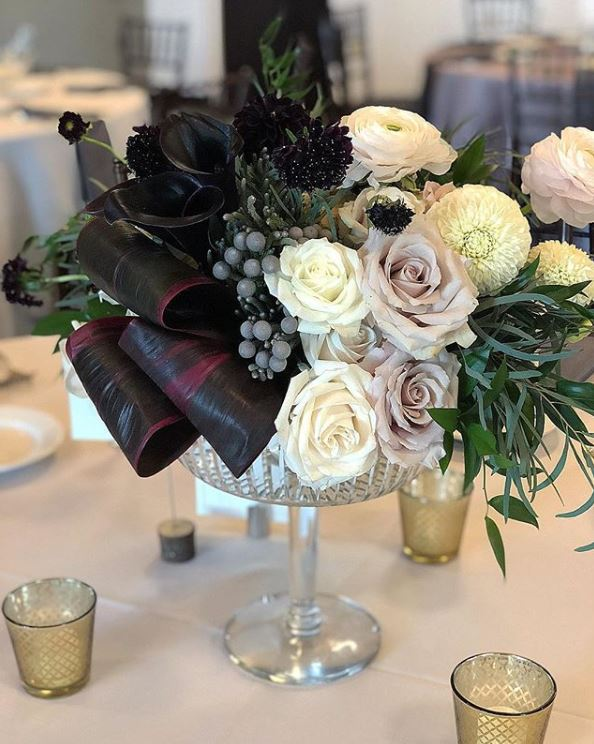Modern Chic Flower Arrangement by Vessel Floral Events featuring black calla lilies, white roses, quicksand roses, dahlias, blush ranunculus, midnight scabiosa, burgundy aspidistra leaves and silver brunia