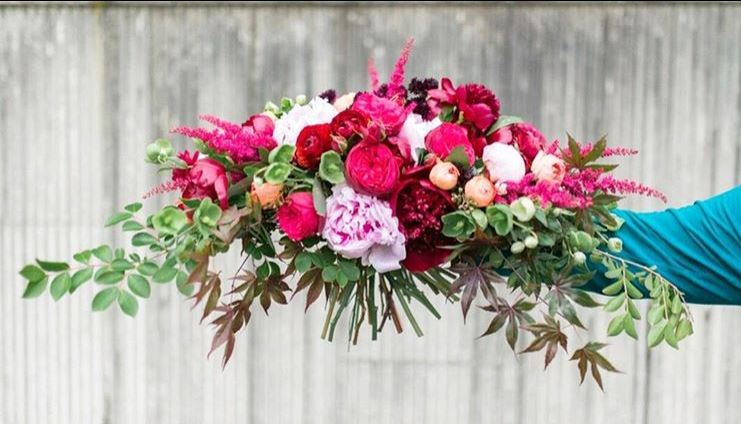 Hot pink Bridal Bouquet by Intrigue Designs with peonies, astilbe and garden roses
