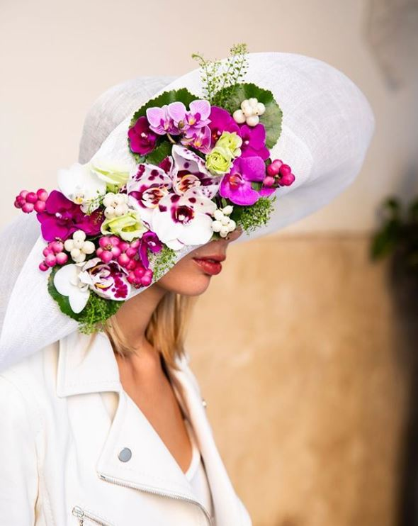 Hot PInk Fower Hat with orchids by Maria Luisa Rocchi Flowers