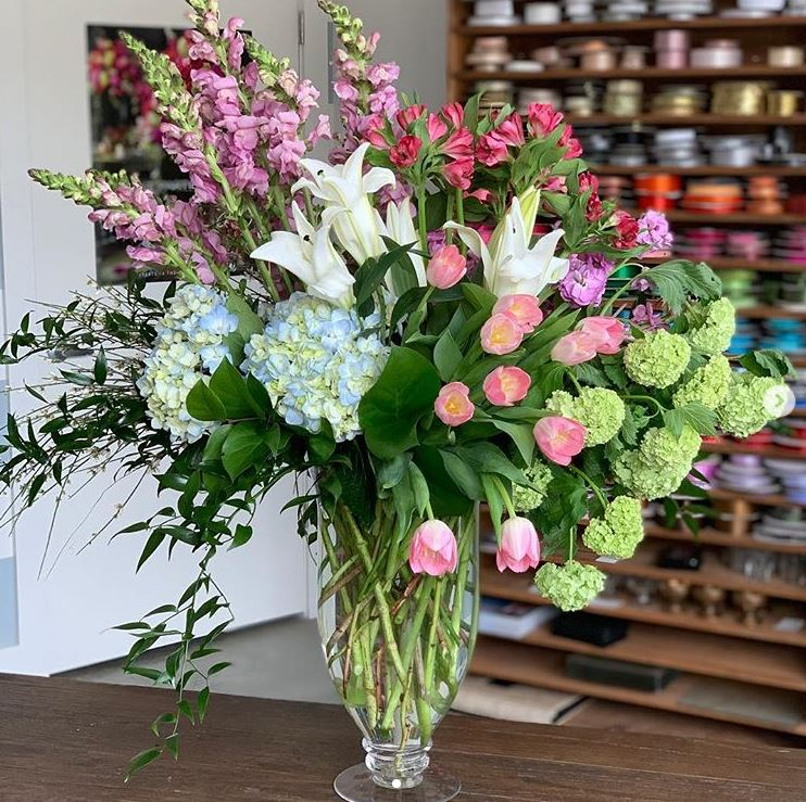 Stunning arrangement of snapdragons, hydrangea, lilies, alstroemeria, tulips, viburnum & ruscus in a glass vase