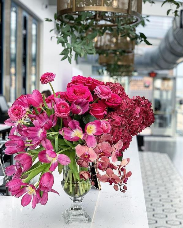 Hot Pink Flower arrangement with tulips, orchids, ranunculus, roses & hydrangea